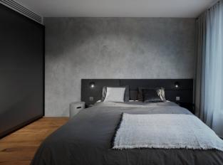 Ložnice s imitací betonu
