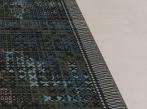 Zátěžový koberec RugXstyle Antwerp v moderním designu Detail designu zátěžového kusového koberce RugXstyle oceněného Red Dot Award.