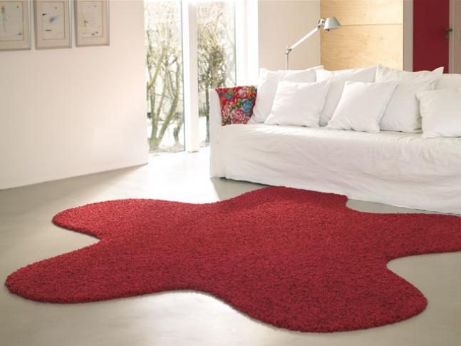 Kusový koberec Fletco rug Červený koberec Fletco Rug Fluffy ve tvaru hvězdice.